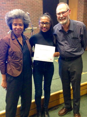 photo of Savitri Persaud, centre, receiving the Grace and David Taylor Graduate Scholarship in Caribbean Studies